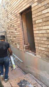 Cementing of outdoor wall in progress